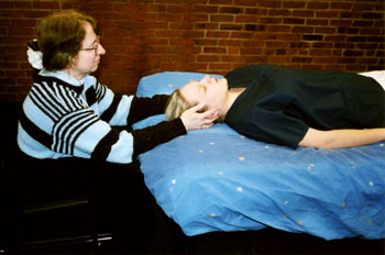 Linda Boucher practicing Reiki